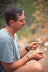 Finishing a spoon made from cottonwood bark.
