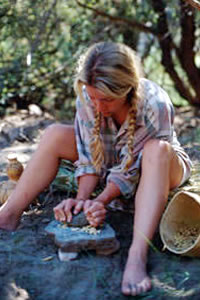 Grinding mesquite pods with mano and metate